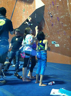Climbers reviewing and sequencing route