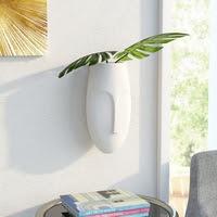 https://www.ceramicwalldecor.com/p/traver-face-ceramic-wall-sculpture.html