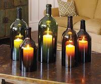 botellas de vidrio recicladas con velas