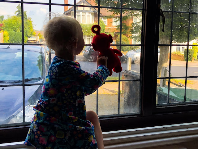 A toddler and Po looking out the window