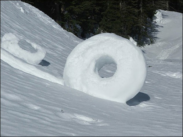 8. Snow donuts: A snow donuts occurs when nature decides to roll up its own type of snow balls (litrally). These rare shapes are formed when a mass of snow either falls or is blown by the wind. If it manages to catch on to some other snow, the gravity/wind will roll it up into a snow donut. These only happen under rare weather conditions, so the chance of finding them in your back yard are slim. - Sometimes Nature Is Awesome. Other Times, It'll Scare The Life Out Of You. Like This.