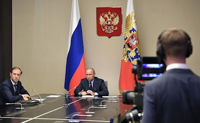 Vladimir Putin at a videoconference on the destruction of Russian last remaining chemical weapons.