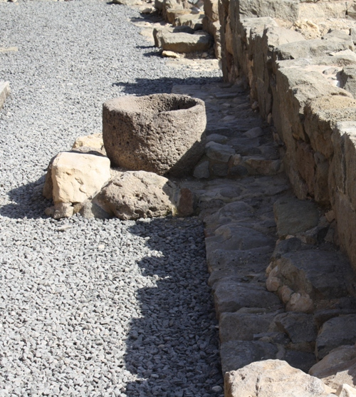 excavated stone storage vessel