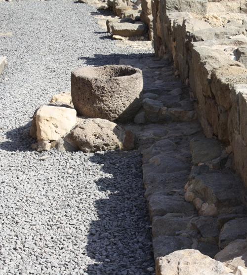 excavated stone storage vessel