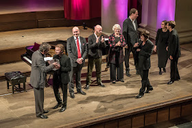 Tom Herring from Sansara receiving the first prize at the 2015 London International A Cappella Competition