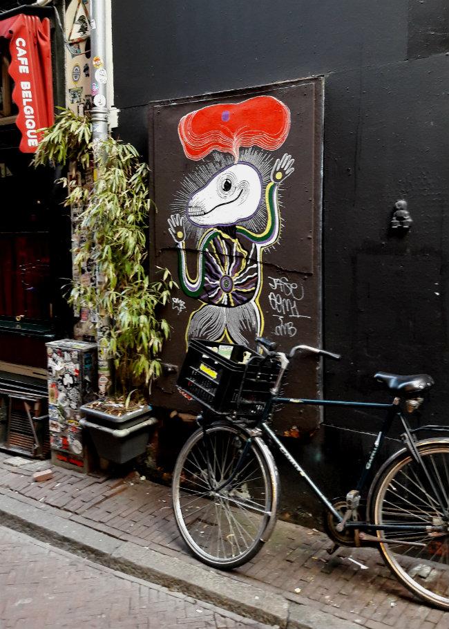 Street art in Amsterdam   Happy in Red