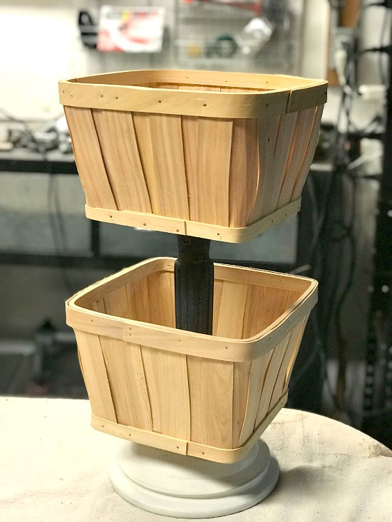 Using baskets to create a tiered planter.