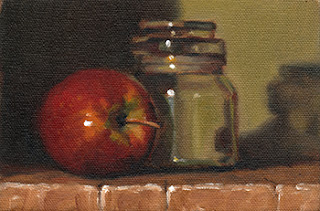 Oil painting of a red apple beside a small glass jar with a glass lid.