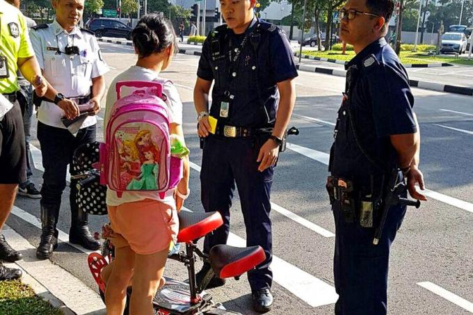 A woman who rode an e-scooter on the road with her child has had her personal mobility device (PMD) impounded.