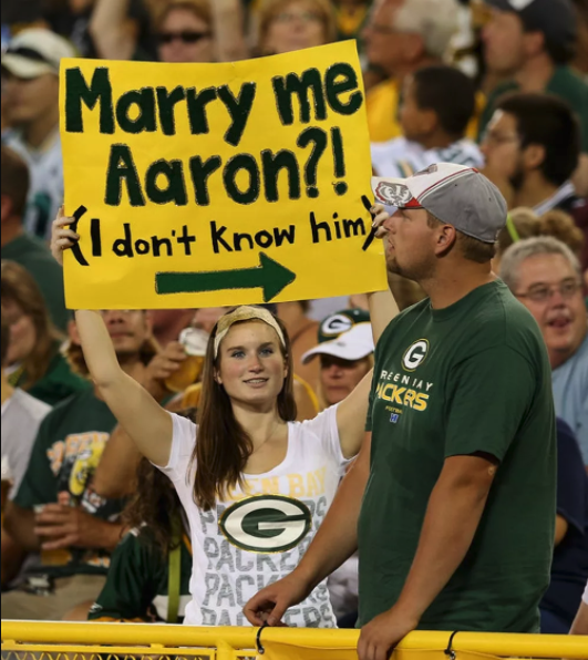 sign at a Green Bay Packers game Marry Me Aaron