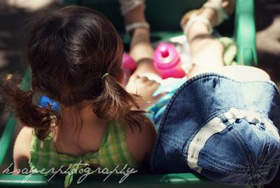 Two little girls in wagon