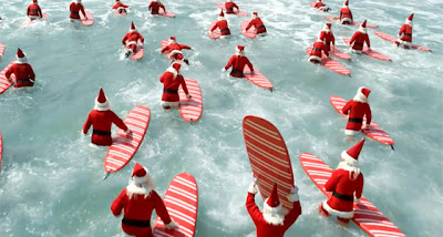 Surfing Santa Claus