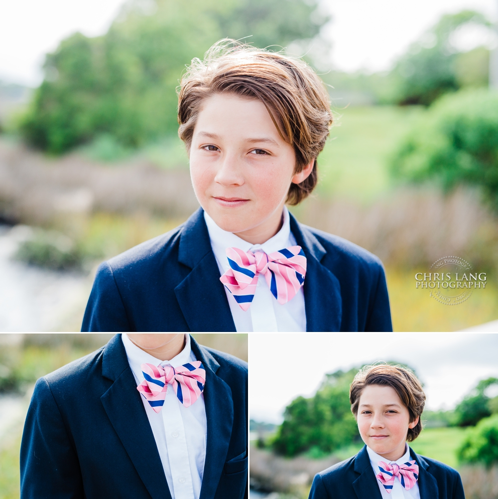 Image of young boy in a navy sports coat with pink and blue bow tie - southern style  - gq kid - wilmington nc photographers