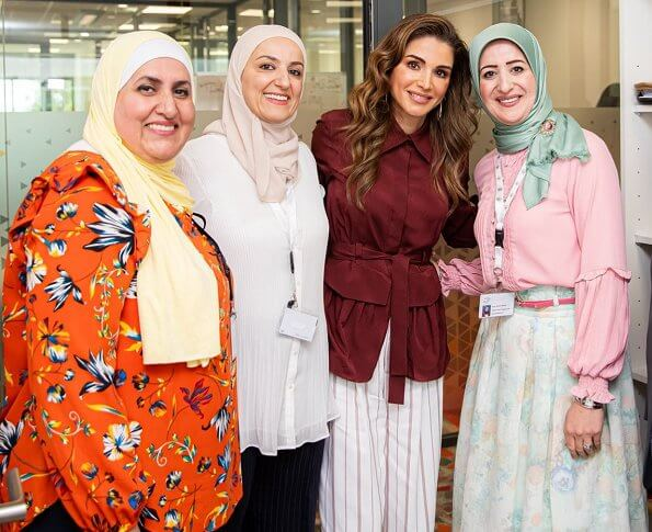 Queen Rania wore Joseph Lin Rayon stripe trousers in ruby. Sheinside burgundy long sleeve asymmetrical belted shirt and blouse