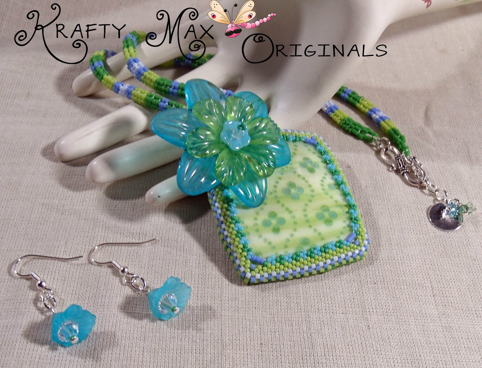http://www.artfire.com/ext/shop/product_view/KraftyMax/8790765/green_and_blue_beadwoven_necklace_set_with_by_krafty_max_originals/handmade/jewelry/necklaces/beadwoven