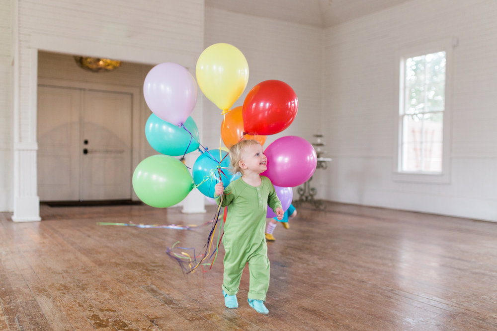 twin birthday, twin two year olds, birthday photoshoot, twin birthday party, twin toddlers, June and January, pearl snap hall, Austin photographer, Austin family photographer, parenting twins, second birthday photos, twin outfits, rainbow birthday, rainbow party, rainbow balloons, boy girl twins, Austin mom blog, twin birthday outfits