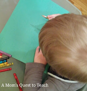 crayons and green paper to trace hands