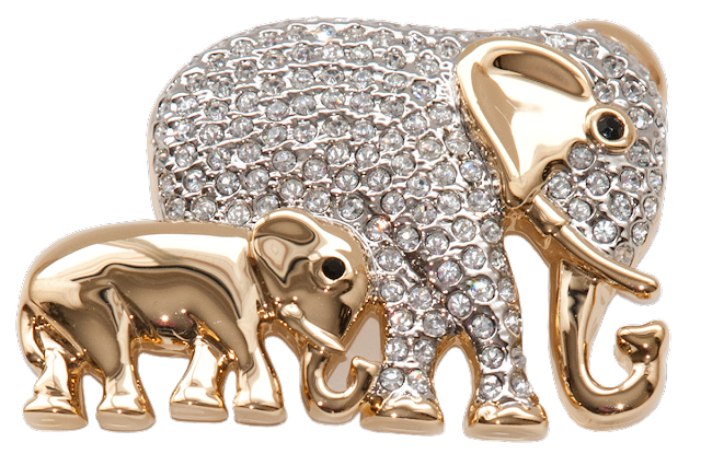 A modern brooch with gold plating and a lot of rhinestones in the shape of a mother elephant and her baby.