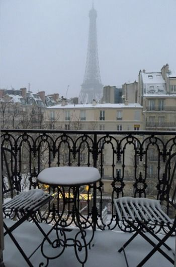 Paris balcony in winter with view of Eiffel Tower
