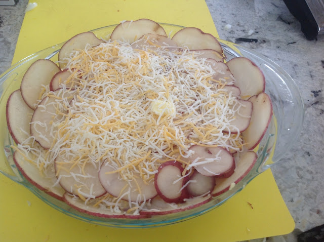 scalloped potatoes and shredded cheese
