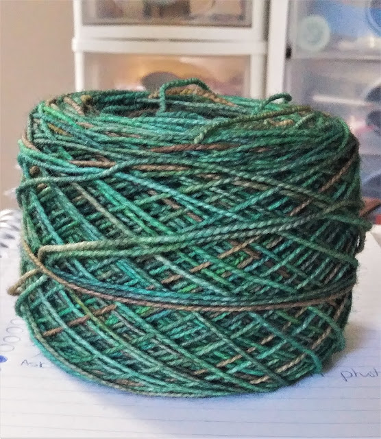 Hawthorne fingering weight yarn from Knit Picks.  Washable wool.