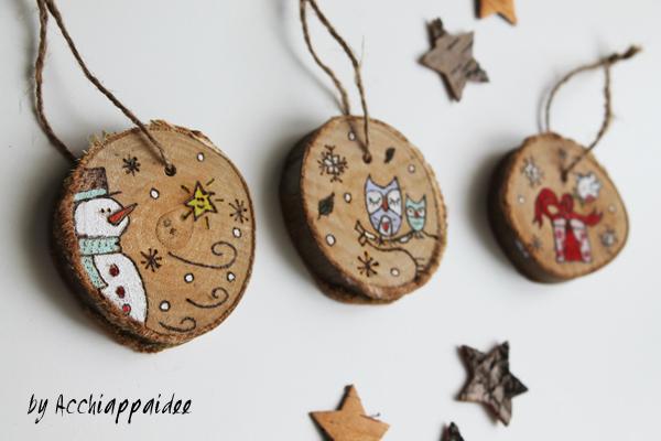 decorazioni su dischi di legno con pirografo
