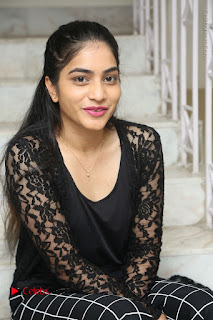 Actress Punarnavi Bhupalam Stills in Black Dress at Pittagoda Press Meet  0093.JPG