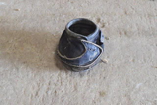 One poultice boot for horses on the ground