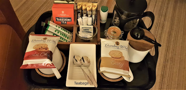 Assortment of teas, coffee, hot chocolate and biscuits in the Patio View room