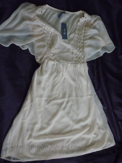floaty cream dress from Peacocks with lace neck detail and wing arms