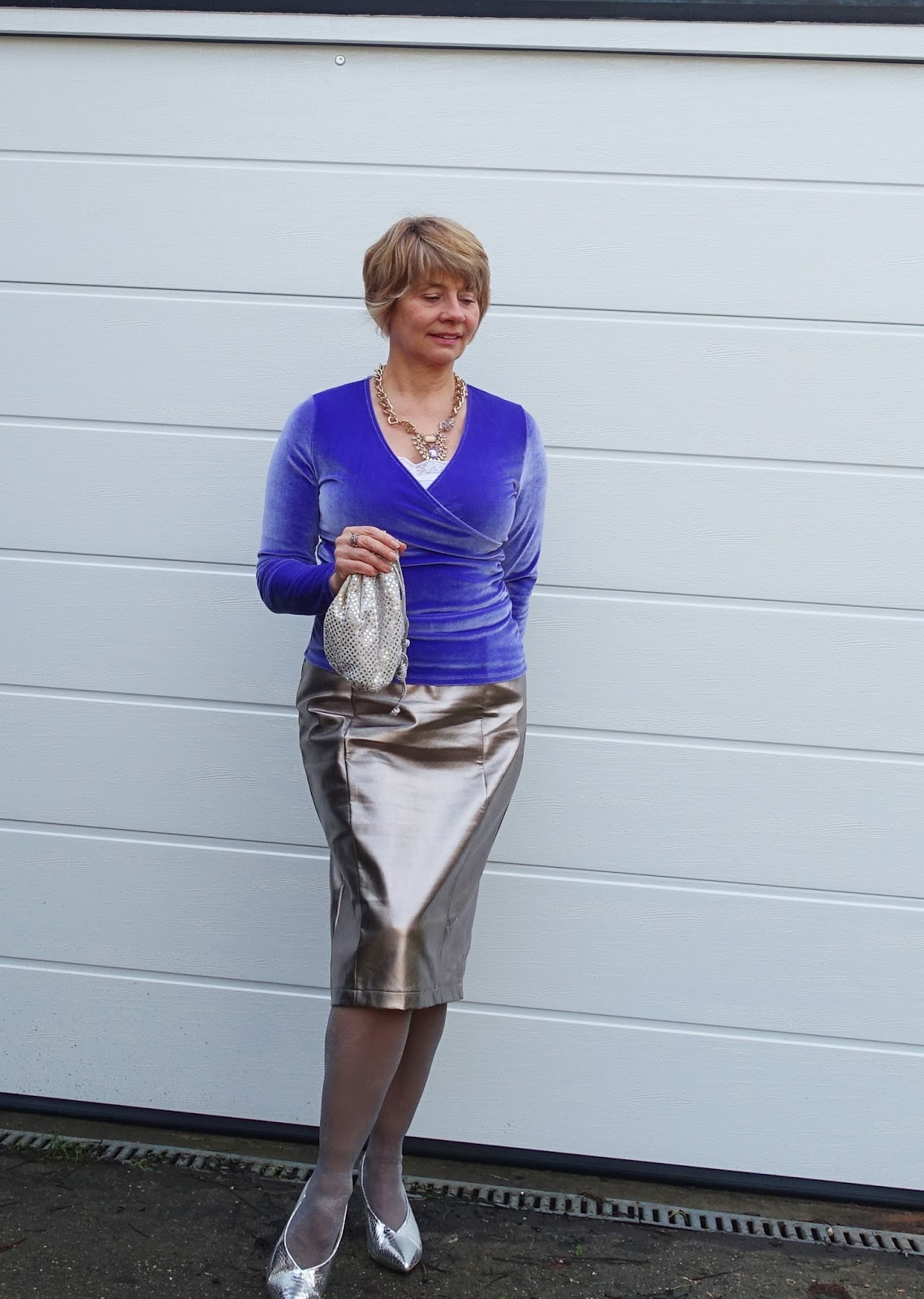 Image showing an over 45 woman in silver leather skirt silver shoes and iris blue velvet wrap top