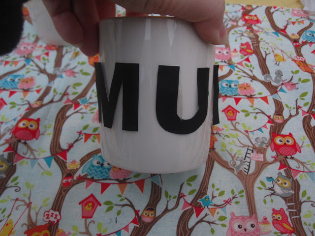 Paper lettering attached to a mug