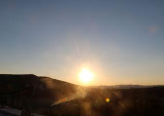 The sun descends towards the horizon