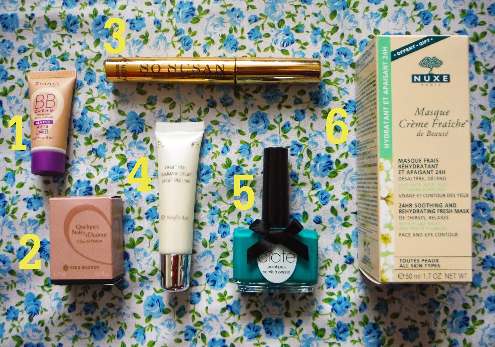 a flat lay of the beauty products received in the october glossybox