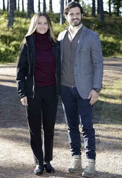 Prince Carl Philip and Sofia Hellqvist at opening of Hykjeberget Nature Reserve. Princess Sofia Hellqvist Style wore new sesion dress bag earring diamond, new sesion wool cardigan sweater coat