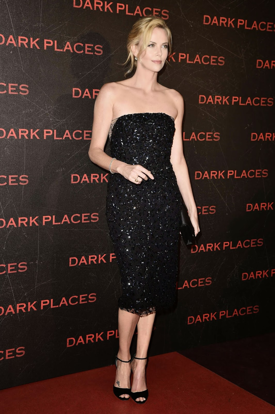 Charlize Theron in a sequinned strapless dress at the 'Dark Places' premiere in Paris