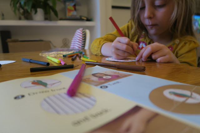 concentrating on designing and colouring