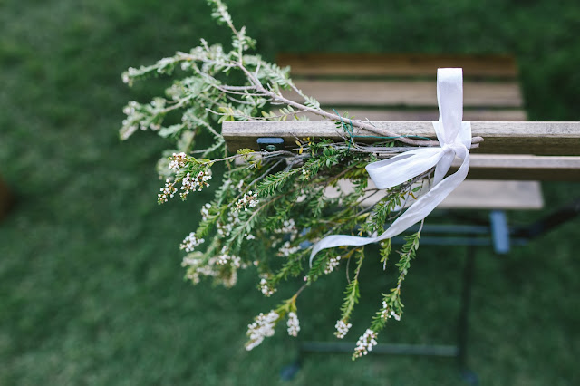 wedding chair adorned with floral greenery swag tied with silk for a classic white garden wedding in utah