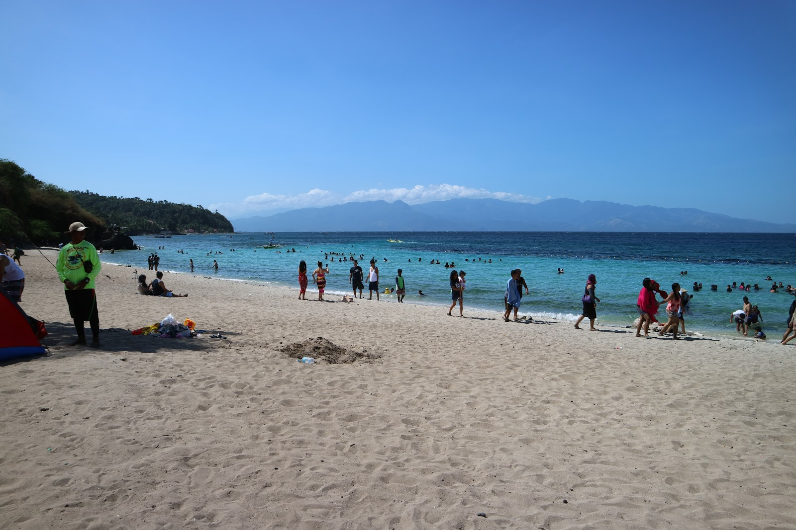Clean Masasa Beach featuring its white sand and clear water