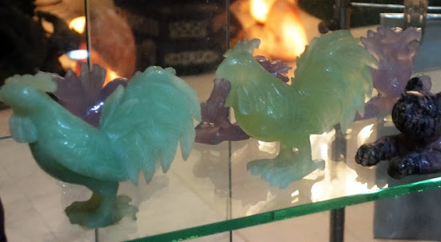 chicken carved from jade with green and lavender color