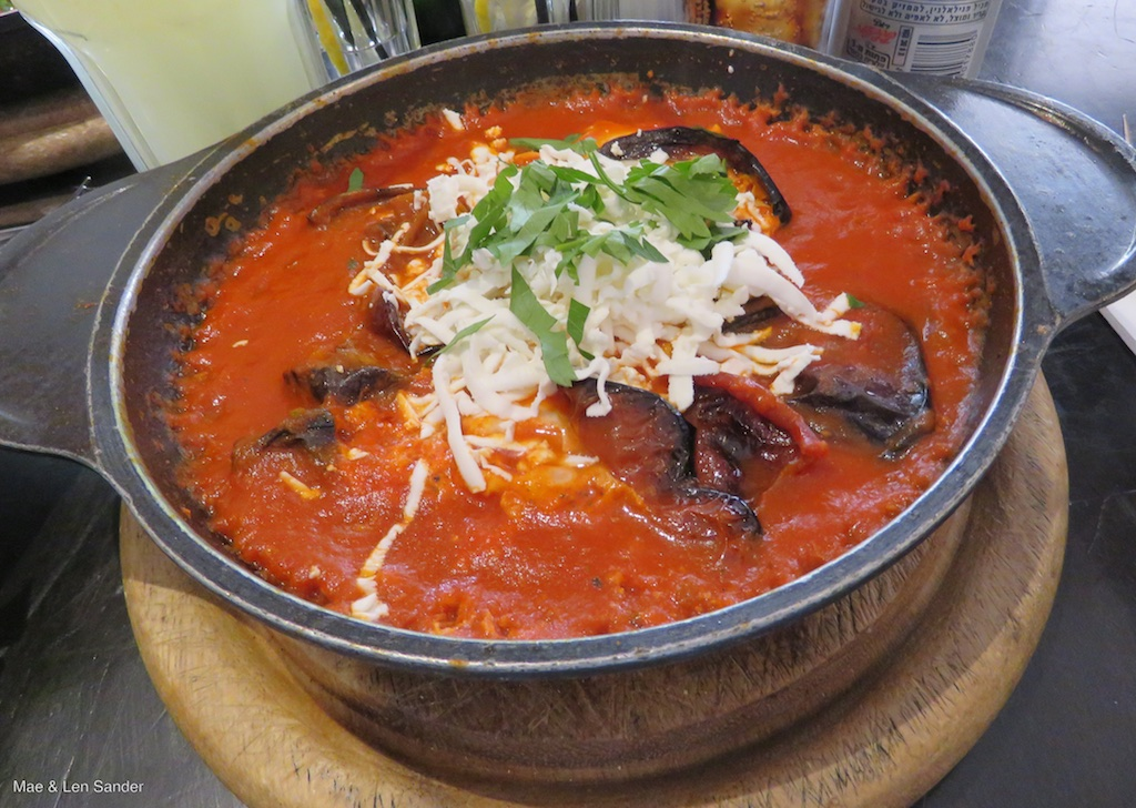 Shakshouka: eggs cooked in tomato sauce, here garnished with fried ...