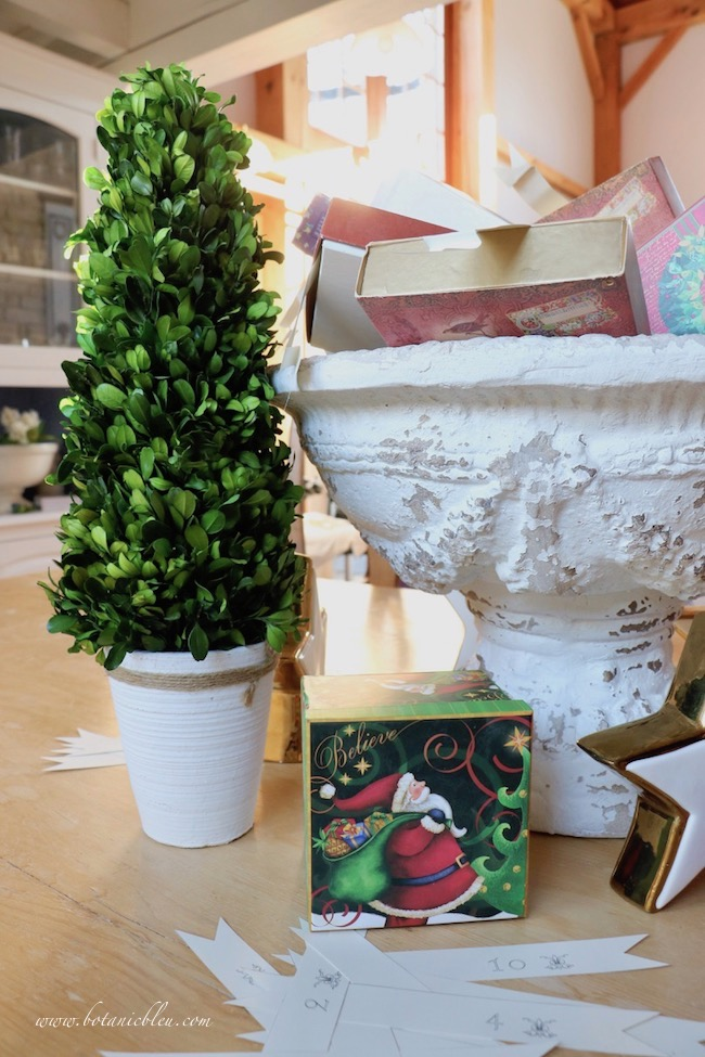Place Advent calendar Christmas boxes in a large urn on the dining table