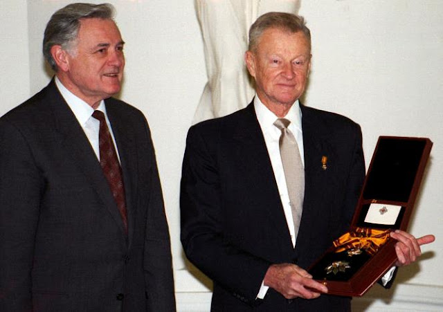 FILE PHOTO - Prominent American political scientist Zbigniew Brzezinski (R) holds the Grand Duke Gediminas medal as Lithuanian President Valdas Adamkus looks on after an awarding ceremony in Vilnius, Lithuania November 17, 1998. REUTERS/File Photo