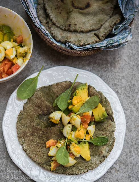 green (agasti leaves) kulcha bread and a wrap stuffed with egg avocado salad