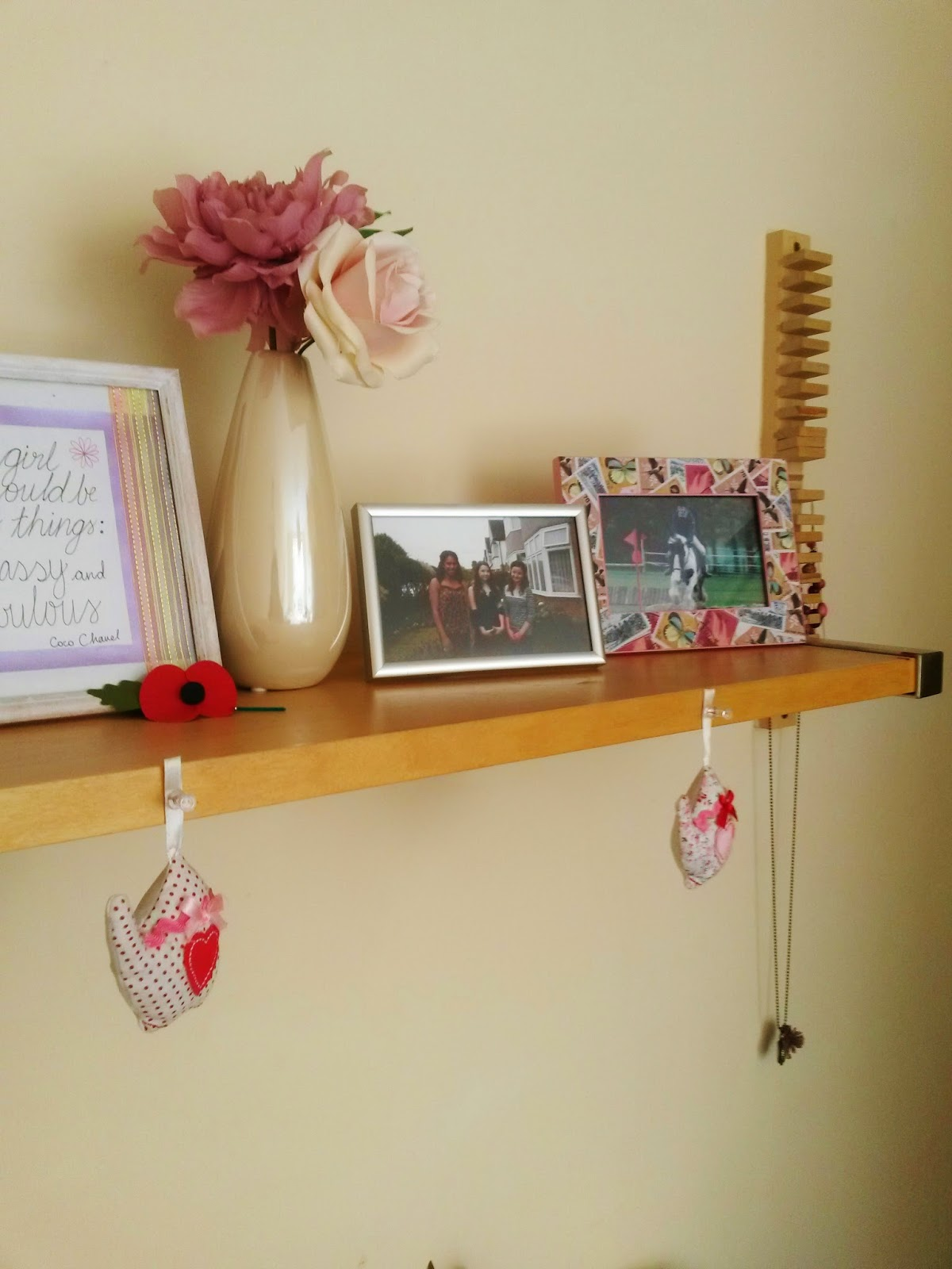 University bedroom photo frames on shelf