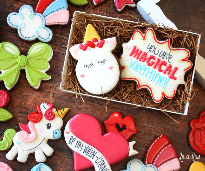Chocolate decorated sugar cookies for Valentine's Day -- unicorns and rainbows and bows!