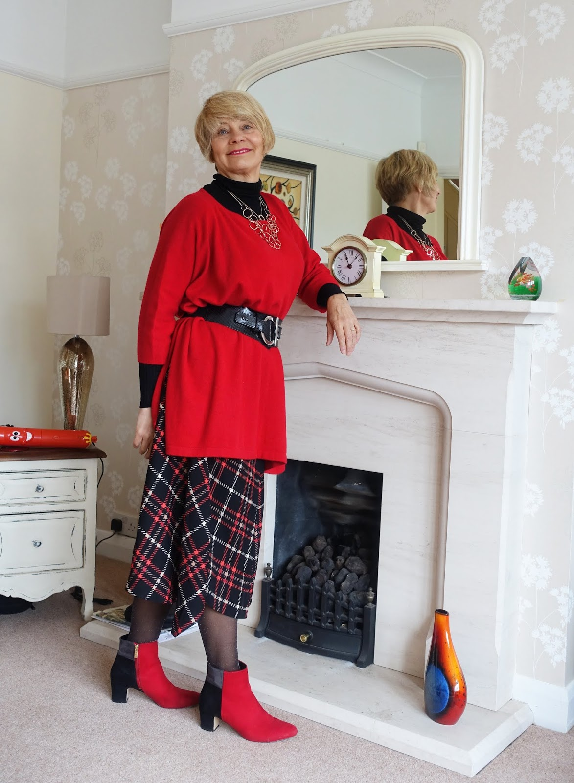A red cashmere poncho with sleeves worn with red and black by over-45s style blogger Gail Hanlon from Is This Mutton dot com