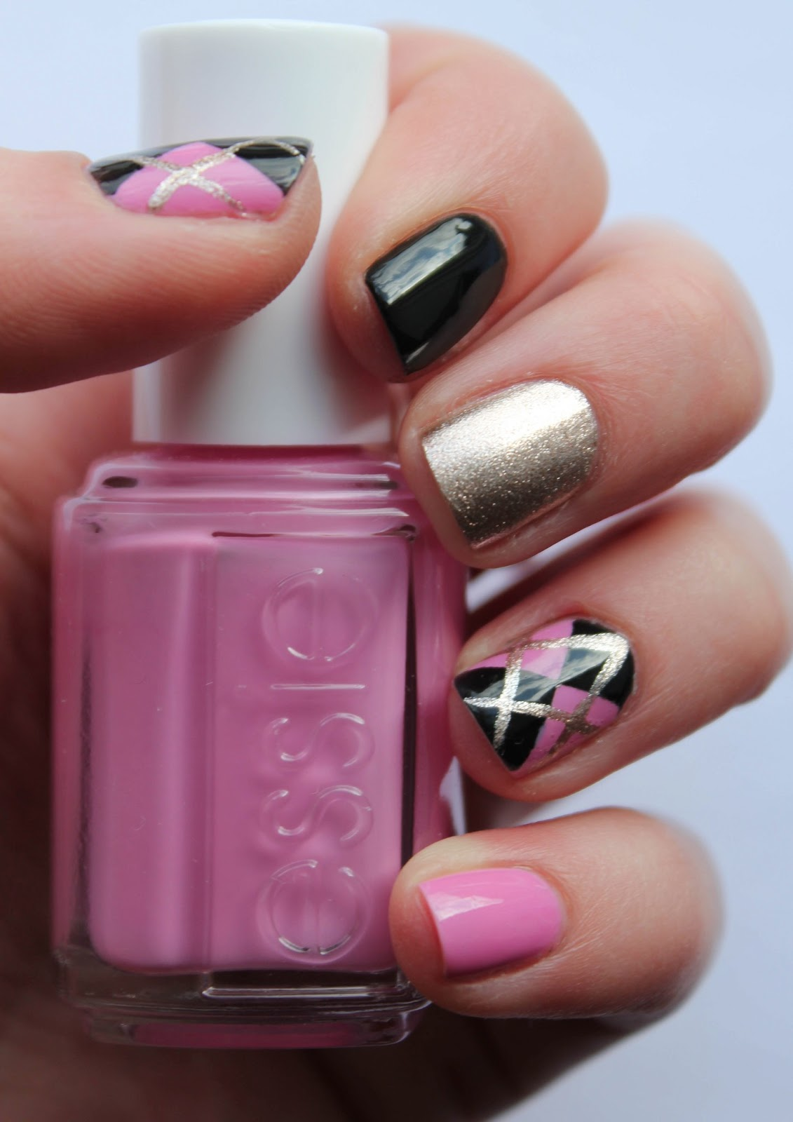 Fundamentally Flawless Black And Pink Argyle Nails