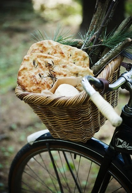 This bicycle basket is perfect for holding picnic snacks like fresh focaccia bread.