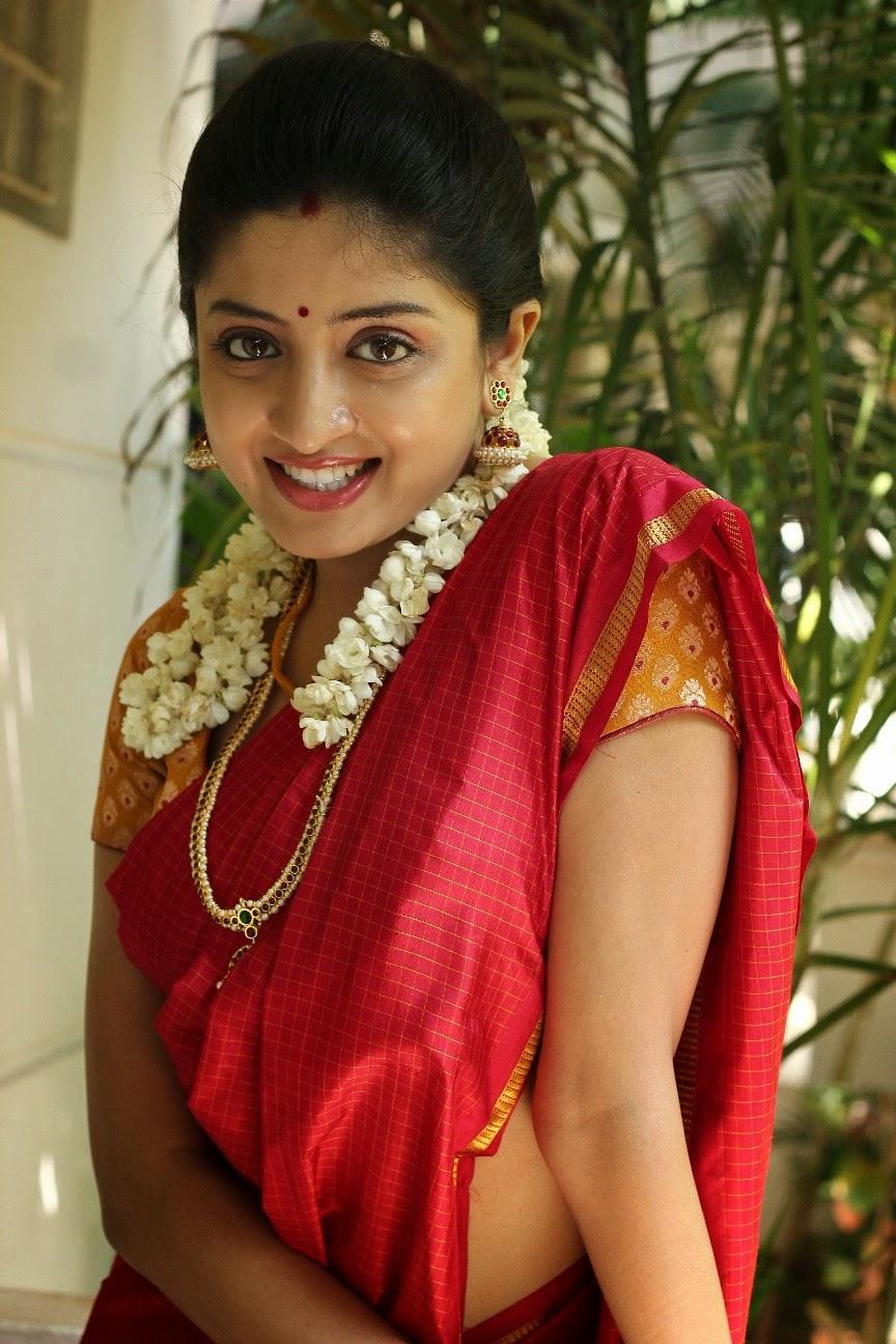Poonam Kaur Spicy Hip Navel Photos In Red Saree